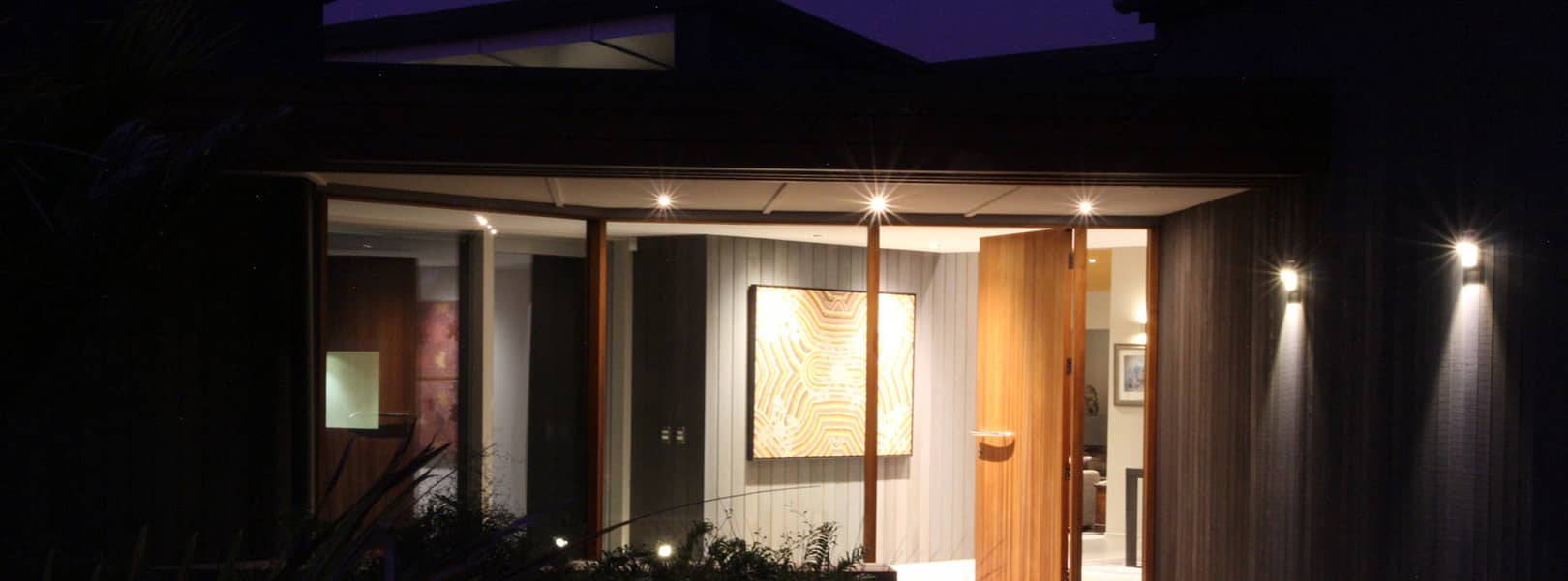 Exterior LED lighting on modern vertical timber weatherboard house