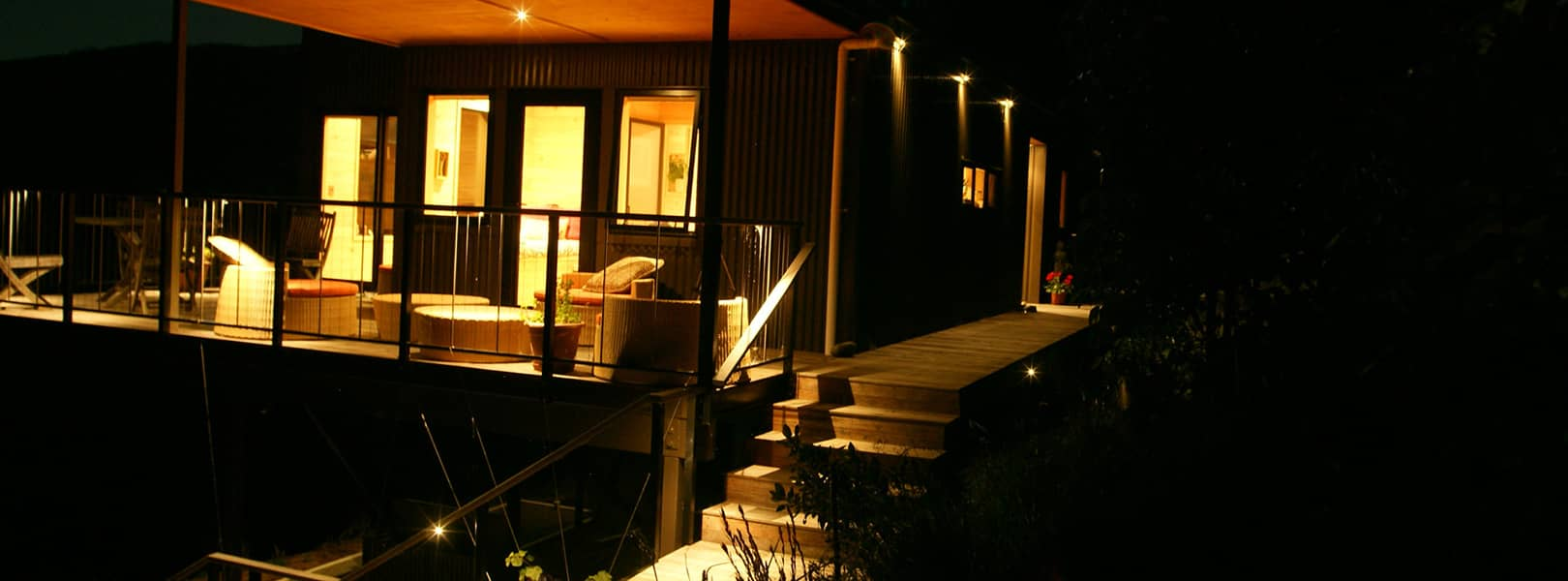 Modern timber deck illuminated by LED downlights recessed into a soffit